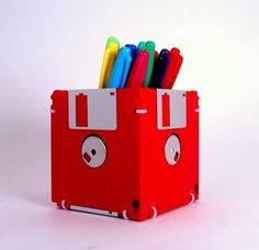 DIY Floppy Disk Pencil Holder. (Or you can buy yourself one right here: http://www.etsy.com/shop/GeekGear?ref=seller_info )