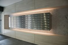 A bank of high-end horizontal stainless steel mailboxes manufactured for a residential development project in London. Wall recessed, fitted in the reception lobby area of the development. Modern Office Design, Workplace Design, Modern Interior Design, Modern Offices, Healthcare Design, Apartment Mailboxes, Office Mailboxes, Luxury Apartments, Luxury Homes