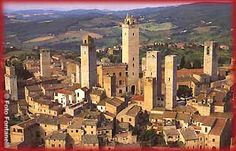 TUSCANY ITALY: San Gimignano, Tuscany Italy. Similar to Siena, famous for it's architectural mid-evil heritage. It is surrounded by the georgous Tuscan countryside, and is a must-see to any Italy vacation. Spectacular views - amazing beauty!