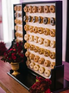 Ideas for the new trend of Doughnut walls for your Wedding Reception. Wedding decorations and Wedding cakes all in one.  A great idea for Party Food & Party Decor too