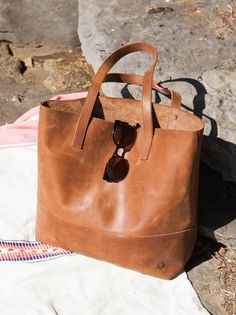 Not only is this leather shoulder tote roomy, but it looks better the worse I treat it!