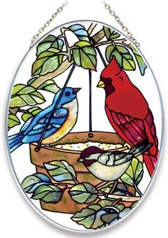 Joan Baker Designs MO100 Birds of a Feather Art Glass Suncatcher, 5-1/4 by 7-Inch by Joan Baker Designs. $12.74. Hand-painted. Translucent artwork looks beautiful from inside or outside the window. Vivid translucent color for window display. Feathered friends gather at the feeder right in your window with this hand-painted art glass Suncatcher for more than 40 years, Joan Baker Designs' talented artisans have created stunning decorative art glass items. Each piece...