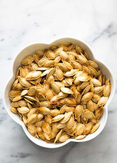 Don't throw away the pumpkin seeds from your pumpkin! Roast them for a delicious healthy Halloween snack #paleo #vegan EASY! on SimplyRecipes.com