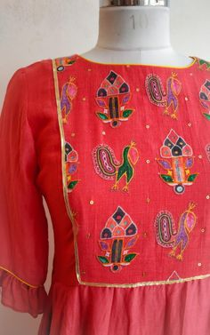 Featuring this pretty Cotton silk tunic with printed yoke and side pleated detail on the waist. It's easy to wear silhouette and printed details make a good semi-formal wear tunic. Fabric: Cotton silk Lining: Shantun Hand Embroidery Dress, Embroidered Blouse, Kurta Designs Women, Blouse Designs, Kutch Work Designs, Semi Formal Dresses, Formal Wear, Black Saree, Silk Tunic