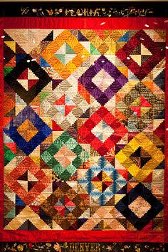"""At the press opening for """"Home Lands: How Women Made the West"""" at the Autry National Center, there were lots of cool things to look at. But the most oohing and ahhing was reserved for this late 19th century silk log cabin quilt."""