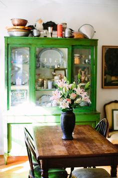 Love the emerald green painted hutch with the classic farmhouse dining table!