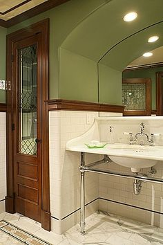 Great Craftsman Full Bathroom.   I like the tile on floor and wall and the green wall color.
