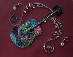 A personal favorite from my Etsy shop https://www.etsy.com/listing/257930249/guitar-melody-quilled-guitar-colorful