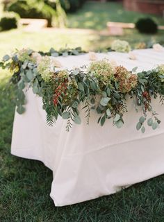 Pretty garland covered table: http://www.stylemepretty.com/2015/11/24/at-home-wedding-in-the-blue-ridge-mountains/ | Photography: Jose Villa – http://josevilla.com/