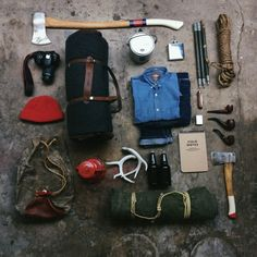 pipes, flask, long handled axe, and the pocket knife