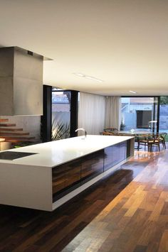 A modern, clean lined kitchen ( We once contemplated a house on the Lake. I thought a sleek modern interior would be low maintenance for a second home. That was a departure thought for a traditionalist. But, it made sense for a working woman. G.S.)