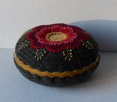 $45.00 Handmade Pin Cushion Felted Wool Red & Gold - 2 1/4 H x 4 1/2 W. Felted wool applique with pearl cotton embroidery with an Old World look. I
