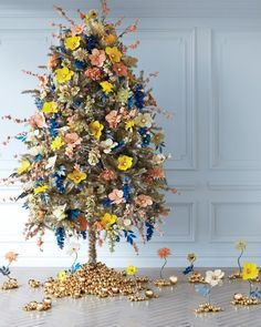 Gold-tinsel tree: The fabric flowers all started out white, sprayed with a vibrant palette and gold ball-pick for centers.