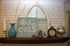 """January/winter mantel rustic glam silver white aqua with """"Baby it's Cold Outside"""" sign"""