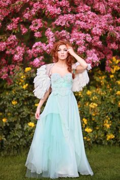 Pale aqua and ruffles make for one gorgeous @Claire la Faye #wedding gown. Angel wings seal the deal!