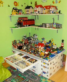 Shelves and Lego table my husband made for my son's room. Besides having four storage drawers, the middle bit also rolls out from under the main table for more building space. The ends of the main table also four drawers for storage.
