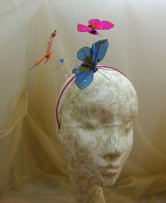 /coral-pink-blue-feather-butterflies