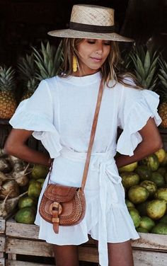 White spring dress - classy, casual, ruffled - tie front waist with yellow tassel earrings, brown leather cross body bag, and woven straw hat