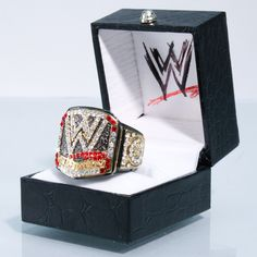 Introducing the Official WWE Championship Replica Finger Ring (2013). The ring contains numerous faux diamonds.