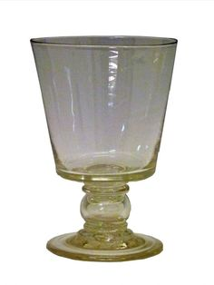Large 19th Century glass rummer having a bucket bowl, the hollow short knopped stem containing a William IV groat 1836, and standing on a circular foot, 18cm high