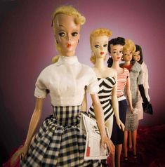 front to back: Bild Lilli, blonde ponytail Barbie, brunette ponytail Barbie, blonde bubblecut Barbie, brunette American girl Barbie.