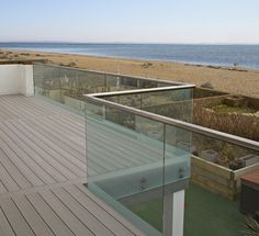 What a beautiful view! We wish we lived this close to the beach. VertiGrain is ideal for raised decks and balconies like this.