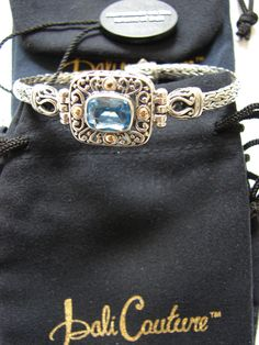 BALI COUTURE GORGEOUS BLUE TOPAZ WOVEN BRACELET IN STERLING SILVER & 18K GOLD http://www.ebay.com/itm/BALI-COUTURE-GORGEOUS-BLUE-TOPAZ-WOVEN-BRACELET-IN-STERLING-SILVER-18K-GOLD-/311459907331?ssPageName=STRK:MESE:IT