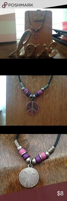 Love Peace Necklace Beautiful, colorful, necklace that says love on it in the center of the peace sign. Great condition. Black leather cord with metal clasp. Jewelry Necklaces