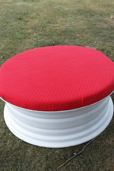 We love this tractor tire rim ottoman! To give a tractor tire rim new life as a cool and cozy piece of furniture, spray paint it and attach a foam top covered in quilted fabric.