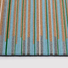 Hella Jongerius combines cork and felt for striped rug collection.
