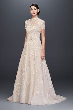Channel Pippa Middleton's wedding dress with this embellished strapless A-line wedding gown from Oleg Cassini features a removable high-neck lace topper that offers coverage and versatility. Shop this style from David's Bridal Colored Wedding Gowns, Princess Wedding Dresses, Modest Wedding Dresses, Designer Wedding Dresses, Bridal Dresses, Davids Bridal Gowns, Lace Wedding, Ivory Dresses, Gown Wedding