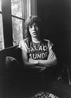 Singer Mick Jagger of the rock and roll band 'The Rolling Stones' poses for a portrait wearing a 'Palace Laundry' tshirt in circa 1970