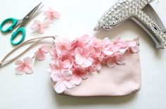 Give your cross body bag a floral update by adding your own flowers!