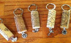 Wine Cork keychain with charm embellishment.