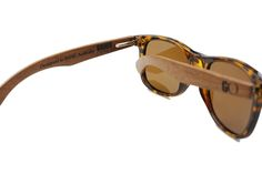 engravings on wooden arms of sunglasses