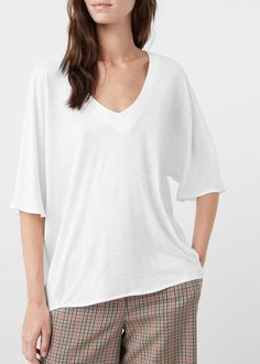 18€ Camiseta fluida - Camisetas de Mujer | MANGO España