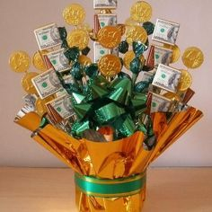 Edible Candy and Money Bouquet, this is cool gift for a guy, it is not real money just a print out, but you could still use real money in other ways to add some gift to it.