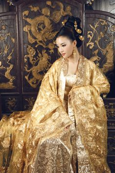 I think it is for noble families because only rich and powerful people from Han dynasty could wear silks and satins. The gold color is very elegant.