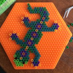 Perler melty bead pattern on large hexagon pegboard