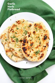 Garlic flatbread recipe No Yeast. This easy garlic herb flatbread has no yeast, doesn't need hours to rest, and has a secret ingredient.   VeganRicha.com #vegan #flatbread #recipe