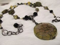 50% off olive web agate necklace...