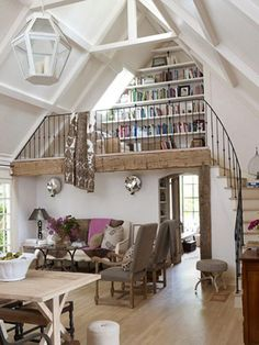 Wow. Talk about a DREAM for me - built in loft library in a dormer. I would die to live here.