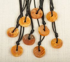A teething necklace made of raw baltic amber.  I think this would be great to put around the adult's neck such that the baby could teethe on it while being carried for long periods of time in a sling.    These exact teethers are offered by Amberies on Etsy.