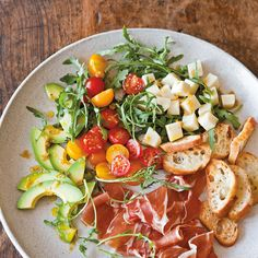 Antipasto Salad with Peperoncini Vinaigrette Recipe Salads with extra-virgin olive oil, garlic, sourdough baguette, salt, red wine vinegar, peperoncini, fresh oregano, sugar, extra-virgin olive oil, cherry tomatoes, avocado, provolone cheese, rocket leaves, prosciutto