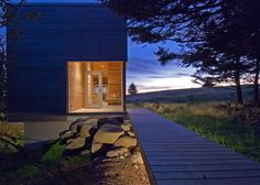 This timber-clad gym and spa building was designed by MacKay-Lyons Sweetapple Architects to accompany a residence on Nova Scotia's Atlantic coast.