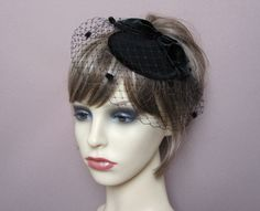 handmade with love in the UK timeless classic black headpiece wool felt base (11cm appr.) trimmed with the velvet bow & french net veiling with chenille dots attached to a slim metal headband for an easy and secure placement perfect for any formal occasion please check delivery time to your country in my shops policies section before placing your order thank you for looking