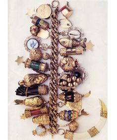 Jackie O's charm bracelet.  Noted: some Diana Vreeland-esque flair in the form of that divine claw or tooth at the bottom.