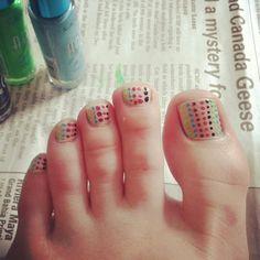 Polka dots. Painted toe nails. Colourful