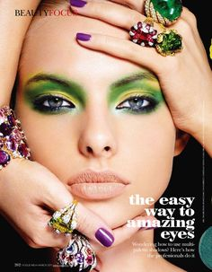 Amazing green and yellow eyeshadow with blue liner and smudge, highlights hazel/ blue eyes. Purple nails and nude lips. Dioni Tabers in Vogue, India  March 2011