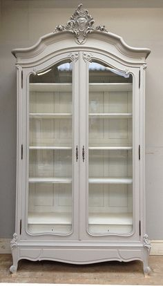 OMG how perfect is this? Glass fronted doors and beautiful carving, all painted white # not-so-shabby chic